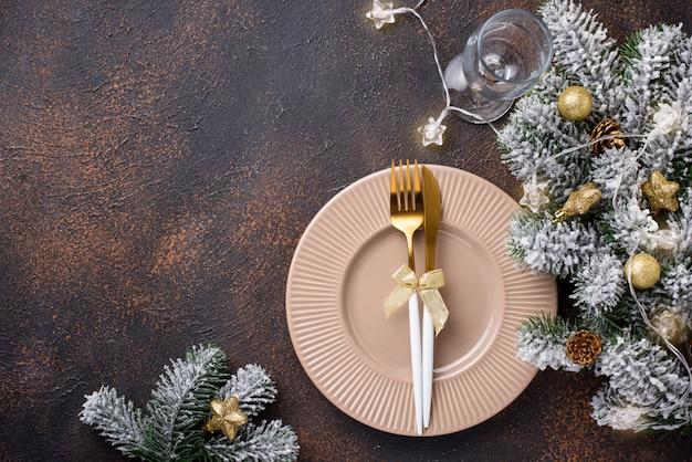 Christmas table setting and golden decor