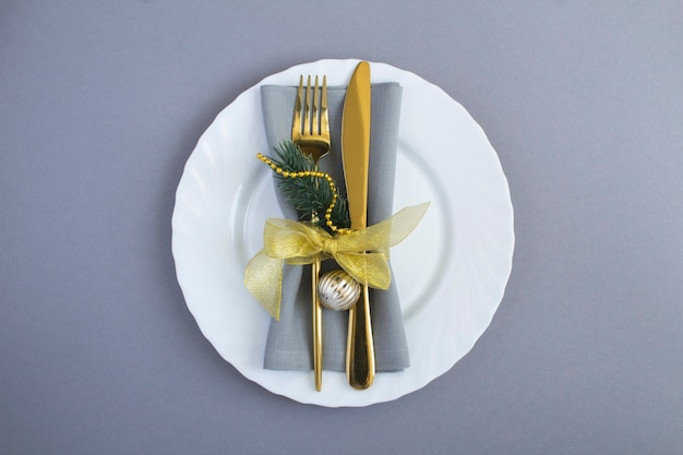 Christmas table setting on the gray background. top view. copy space.