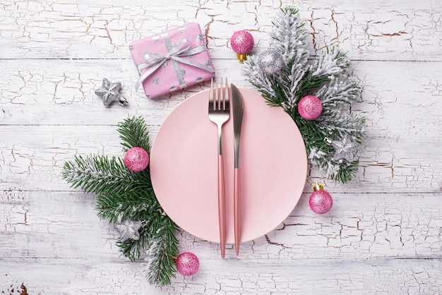 Christmas table setting in pink color