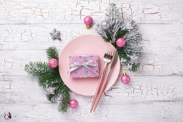 Christmas table setting in pink with branches