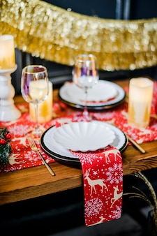Christmas table setting in traditional colors