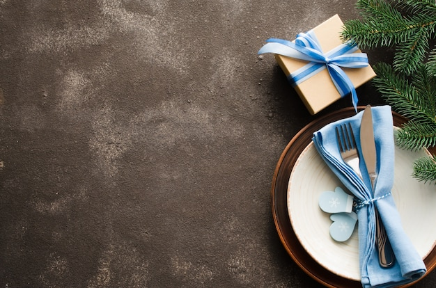 Christmas table setting. winter  for writing the christmas or new year menu.
