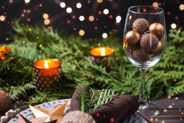 Christmas table setting with decorations fir branches and candles