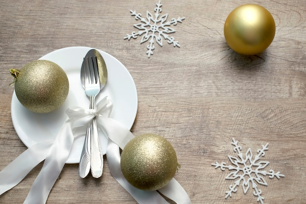 Christmas table setting with decorations on wooden table, holiday background.