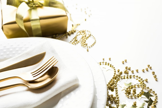 Christmas table setting with golden dishware