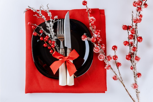 Christmas table setting with red berry branch. christmas decoration.