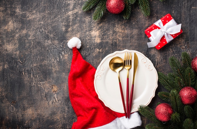 Christmas table setting with red decor