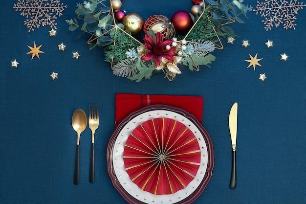 Christmas table setup with white plates