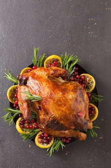 Christmas table with baked turkey or chicken, copy space for text. christmas dinner,