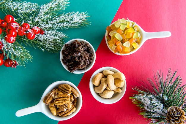 Christmas table with candied fruits, raisins, walnuts and cashew nuts.