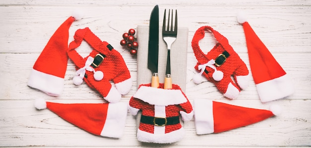 Christmas tableware on wooden table
