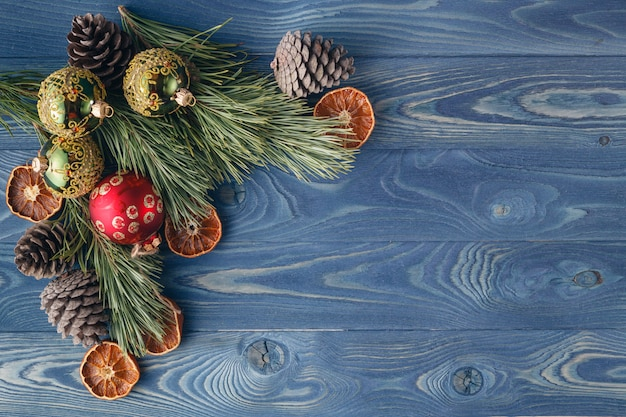 Christmas tale. the frame of the trees.themes christmas decorations, fir cones, snow and festive mood