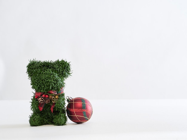 Christmas teddy bear and decorations with copyspace