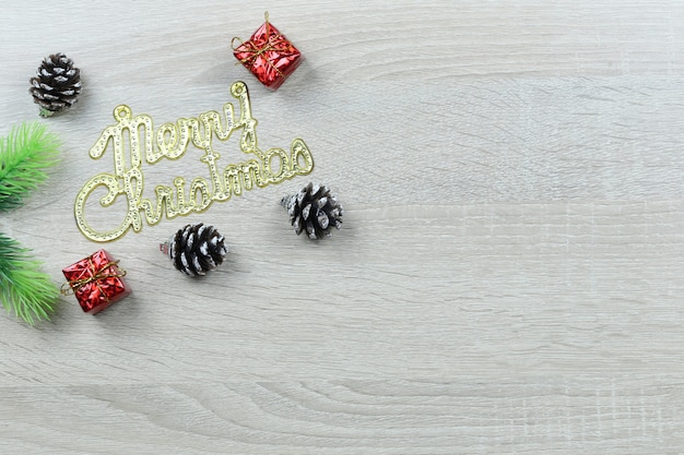 Christmas text decoration on wooden floor.