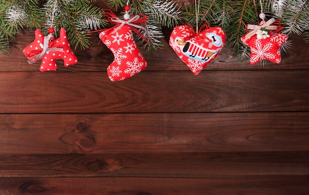 Christmas textile decoration on a wooden background