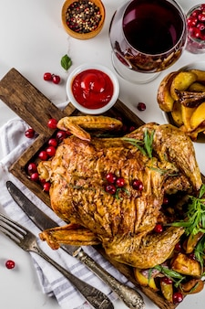 Christmas, thanksgiving food, baked roasted chicken with cranberry and herbs