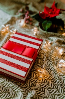 Christmas themed gift box with a poinsettia
