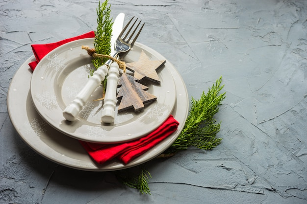 Christmas time in interior with festive table setting