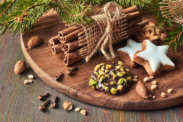 Christmas time with various cookies with nuts and spices