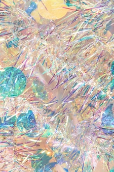 Christmas tinsel garland texture abstract background in pastel colors.