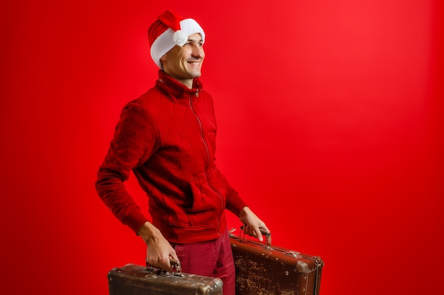 Christmas, tourist trip concept. santa claus with suitcases is going to travel around the planet. christmas time.