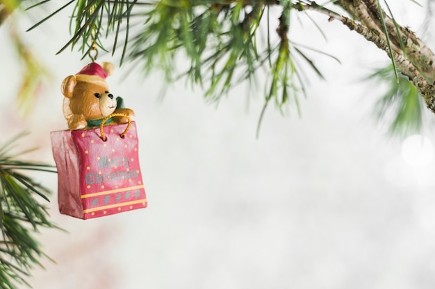 Christmas toy hanging on green fir tree