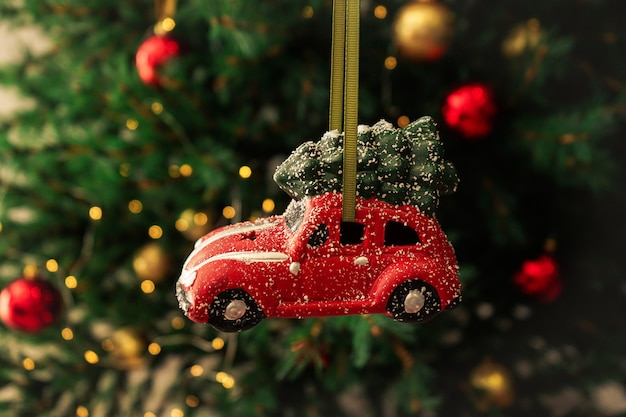 Christmas toy red car on new year tree. christmas composition.