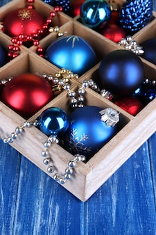 Christmas toys in box on wooden table close-up