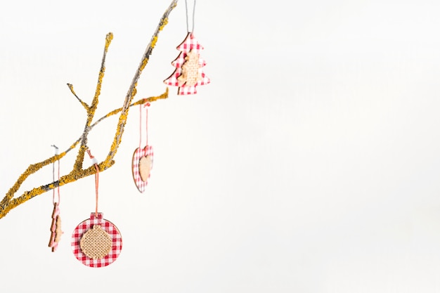 Christmas toys hanging on tree branch
