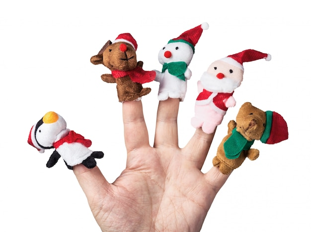 Christmas toys put on a hand on a white