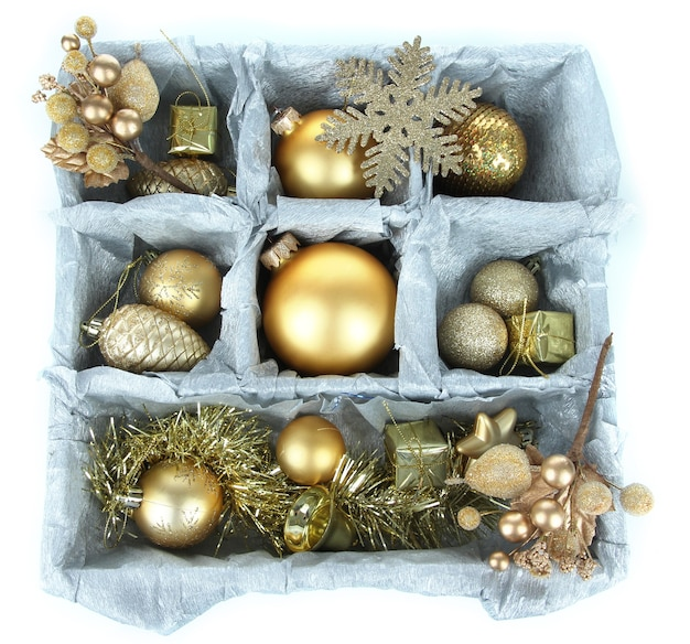 Christmas toys in wooden box isolated on white