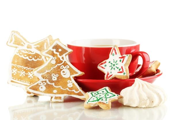 クリスマスは白で隔離のコーヒーのカップで扱います Premium写真