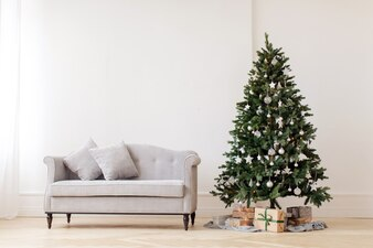 Christmas tree and gray couch
