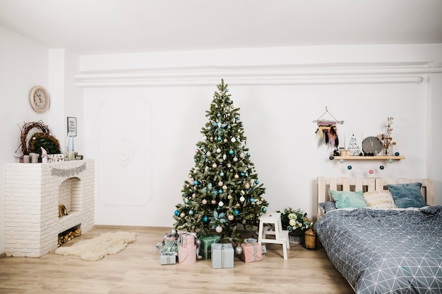 Christmas tree next to bed