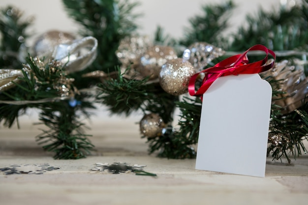 Christmas tree branch with a blank note