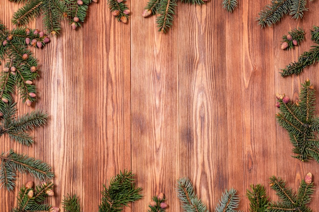 Christmas tree branches on a wooden background. new year's copy space