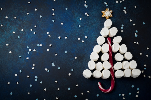 Christmas tree candy, gingerbread, marshmallows and confectioner's multicolored powder