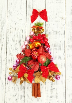 Christmas tree of christmas toys on wooden table close-up