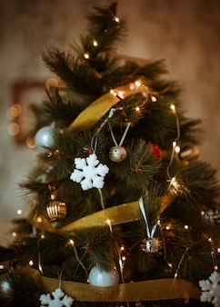 Christmas tree decorated with golden and white ornaments