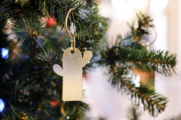 Christmas tree decoration shaped cactus with blurred bokeh background