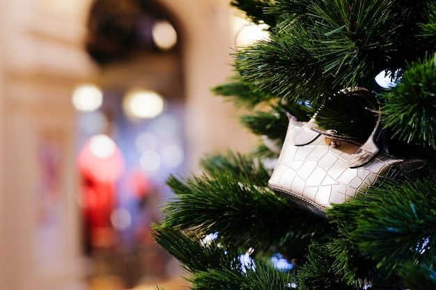 Christmas tree decoration shopping bag with blurred bokeh background
