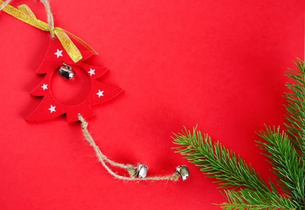Christmas tree decoration toy on red . top view. frame composition, copyspace. greeting card .