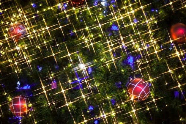 Christmas tree decorations lit background