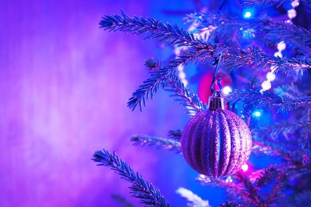 Christmas tree decorations purple background
