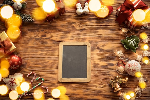 Christmas tree decorations on wooden table
