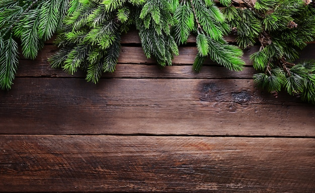 Christmas tree frame on wooden background