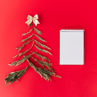 Christmas tree from fir tree branches with notepad