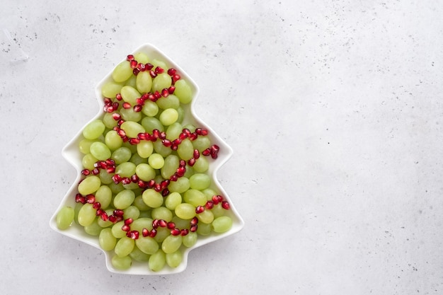 Christmas tree fruit salad with grapes and pomegranate