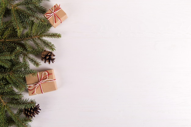 Christmas tree, gifts and pine cones, copyspace. greeting card with place for text.