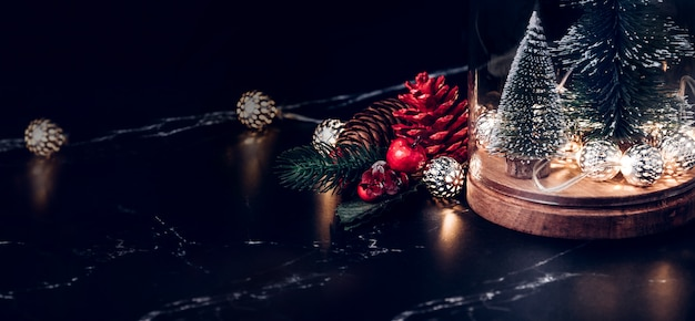 Christmas tree and glowing light string and pine cone and mistletoe decoration